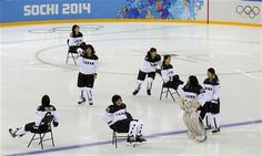 Members of the Japan women's ice hockey team slide on chairs prior their practice session ahead of the 2014 Winter Olympics, Thursday, Feb. ...