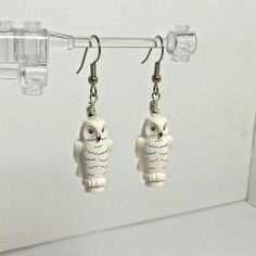 """This White Owl is the most popular and well-known of the various LEGO® Owls. Hedwig is direct from Harry Potter collection, and here he is just for you.  These earrings are very light weight and comfortable to wear. The earring material is hypoallergenic surgical steel.  All parts are securely attached, and the approximate measurements are 1"""" x 1/2"""".   Any Questions? Please contact me and you will receive a response ASAP. Fun and Function is such a nice combo!  Enjoy!  Val"""