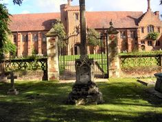church of St Etheldreda  cemetary with Hatfield House in the backround