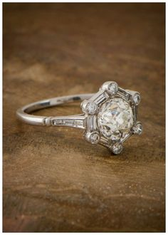 Love these antique rings, so beauriful. An Art Deco style engagement ring with a unique hexagonal setting.