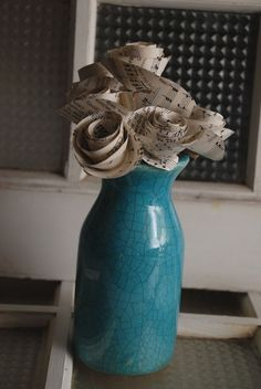 Turquoise antiqued vase with sheet music by The Salvaged Home