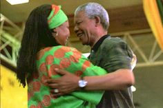 BLOEMFONTEIN, SOUTH AFRICA - DECEMBER 21: South African President Nelson Mandela (R) congratulates his wife Winnie after she has been elected to the National Executive Committee of the African National Congress (ANC) on the last day of its 49th constitutional congress in Bloemfontein, South Africa, 21 December 1994. The Mandela's have been seperated since 1992. (Photo credit should read WALTER DHLADHLA/AFP/Getty Images)
