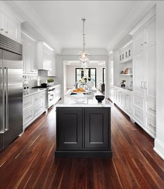 If you are having a sleek and modern theme kitchen in your house, you might need to have some of these best galley kitchen ideas. There are a lot of design ideas you can take as inspiration in this article. Luxury Interior Design, Home Interior, Home Design, Monochrome Interior, Interior Decorating, Black Kitchen Island, White Kitchen Cabinets, Galley Kitchen Island, Kitchen White