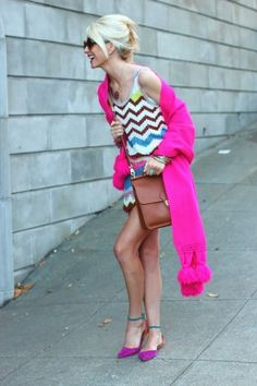 love this combo. Wearing colour block shoes? Your outfit should have some colour up top to balance out the whole look. Like this bright pink #cardigan here with the colour print #dress