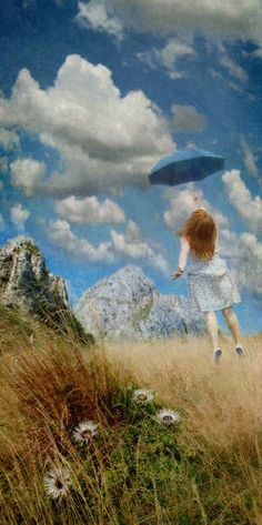 this picture reminds me SO much of one of my first memories.  I remember being in a car, looking out the window up at the sky and all I saw was this exact brilliant blue and the clouds......I'll never forget it <3