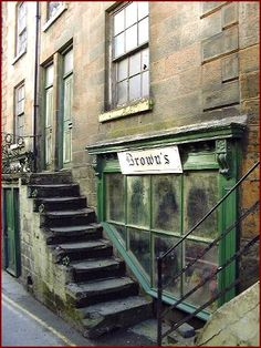 Robin Hoods Bay Brown's Shop 2001 by North Yorks CAM This was a newsagents and gift shop run by Hazel Brown an eccentric lady who was a bit scary but kind to us children Visit Yorkshire, Yorkshire England, North Yorkshire, Robin Hoods Bay, Northern England, Holiday Places, Old Street, Interesting Buildings, Shop Fronts