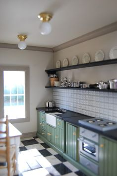Beautiful miniature dollhouse kitchen. I like the checkered floor for the kitchen?