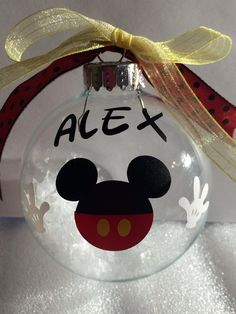 Glass OR plastic ornament with silver metal cap; vinyl Mickey appliqué, ribbons, and recycled plastic snow inside. I can also make them with Minnie for a girls birthday.** I also offer the Minnie ornament: Mickey Mouse Christmas Tree, Mickey Mouse Ornaments, Mickey Mouse Crafts, Disney Christmas Decorations, Mickey Mouse Decorations, Disney Ornaments, Christmas Ornament Crafts, Christmas Bulbs, Christmas Projects