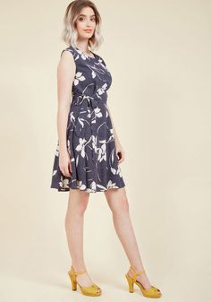 <p>Go where you want, do as you please, and look incredible while indulging your desires in this navy dress! A ModCloth exclusive, this flirty treat inspires a carefree vibe with its seamless cap sleeves, ivory flower-and-dot print, and figure-highlighting waistline tie. Bliss, exemplified!</p>