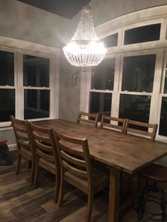 Dining in style!  Farmhouse table with fabulous chandelier!  #oceanislebeach #anyportinastorm #vacation
