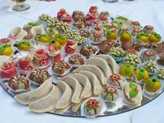 Moroccan food recipes dessert snake pastry with fig almond paste moroccan dessert display gives guests a wide selection of delicious treats forumfinder Images