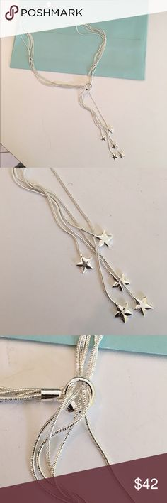 Multistrand silver shooting star lariat necklace Does beautiful silver shooting star lariat necklace is an amazing piece. 18 inches long with 2 inch of dangling stars. Perfect for the superstore in your life Jewelry Necklaces