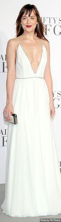 Dakota Johnson Wearing Saint Laurent Dress, Sidney Garber Pearl Ring, Roger Vivier Clutch and Christian Louboutin sandals: