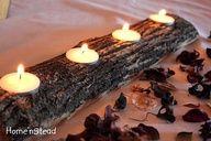 boor in een stuk hout dat  de kaarsjes er in passen