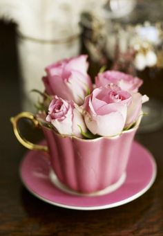 Pink roses in a pink teacup will be perfect as centerpiece