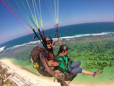 Flying together in the gorgeous Bali Skies. ...#BaliBliss2015 #templepilots #paragliding #onelove #loveisintheair