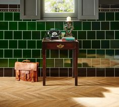 Hallway perfection. Original Style's Victorian Green tiles paired with herringbone wood-effect flooring creates a welcoming space and is a stylish introduction to any home.