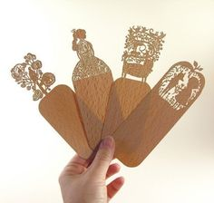 Set of four laser-cut wooden bookmarks featuring simple children's scenes or fairy tale moments. #bookmarks #fairytales