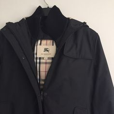 Burberry coat Beautiful Burberry coat only worn a few times in Excellent condition. Black exterior, plaid interior. Sweater standup collar and cuffs. Hooded. Very warm for winter. Burberry Jackets & Coats