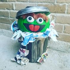 Oscar the grouch pumpkin. Pumpkin decorating contest. Ping pong ball eyes and painted flower pot trash can.
