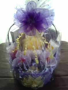 Mother's Day/ spa basket.  It comes with body scrub and lotion, sponge, facial scrub pads, manicure set, nail polish, candle,note pad and handmade pen. $ 50.00