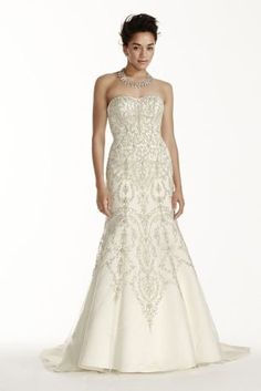 """This strapless mermaid dress will have you looking amazing on your special day!  4"""" extra length dress.  Strapless tulle mermaid dress features dazzling crystals and ivory beaded embroidery with sweetheart neckline and a low scoop back.  Chapel train.  Fully lined. Back zipper. Imported. Dry clean only.  Also available in Regular, Plus Size, Petite, and Extra Length Plus Size. Check your local stores for availability. Cherish your wedding dress forever with our Gown Preservation Kit."""