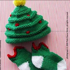 Christmas knitting pattern baby hat and socks. I need to 1) learn to knit better and 2) have a cutie to put this on!