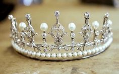 This is said to be a photo of Crown Princess Mary's wedding tiara with added pearls, but somehow it looks a little off to me.  Might just be the photo, but the pearls in most of the pictures showing the princess wearing it look  a darker cream color than these. Curious.