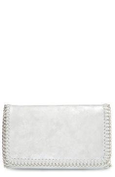 Featuring whipstitched and chain-link trim, this spacious flap bag from the Nordstrom Anniversary Sale is finished with a drop-in chain strap.