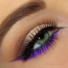 Bright purple lined neutral eye makeup.