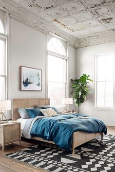 Cheap Home Decor A caned headboard and nightstand mixed with boldly patterned rug and linen bedding equal a confident a cool bedroom. Home Bedroom, Bedroom Decor, Calm Bedroom, Master Bedroom, Bedroom Retreat, Bedroom Ideas, Home Interior, Interior Design, Design Design