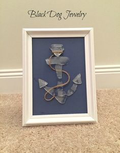 This anchor sea glass art features genuine sea glass that was found on the beaches of the Treasure Coast, Florida.  11 pieces of white