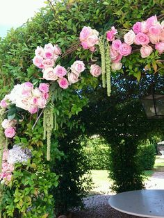 Arch of flowers with pink roses