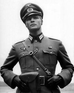 """Hugo Boss Nazi Uniform - Because of his early Nazi party membership, his financial support of the SS and the uniforms delivered to the Nazi party, Boss was considered both an """"activist"""" and a """"supporter and beneficiary of National Socialism"""". In a 1946 judgment he was stripped of his voting rights, his capacity to run a business, and fined """"a very heavy penalty"""" of 100,000 DM ($70,553 U.S. dollars). He died in 1948, but his business survived. (source: Wikipedia)"""