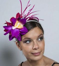 Fascinator with an orchid and feathers.