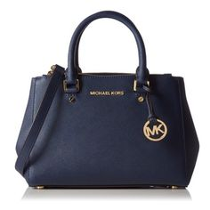 """!SOLD!! NWT Michael Kors Sutton Small Satchel Navy NWT Michael Kors Sutton Small Satchel Navy Classic navy blue saffiano crosshatch finished leather with polished golden tone hardware and accents Logo print fabric lined interior with zippered pocket, (4) open slip pockets and key clip Dual walled zippered compartments on front and back with an open top center compartment with magnetic closure Dual rolled leather handles with a 4"""" drop or use the removable and adjustable leather shoulder…"""
