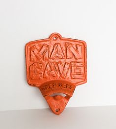 *****Combined Shipping On All Items In My Shop*****   Man Cave Cast Iron Bottle Your functional pieces dont have to be drab. Man Cave Cast Iron Bottle Opener features heavy cast iron with a gorgeous real orange color.  This piece is an easy way to remove tops from bottles. It is perfect for hanging on the wall in your man cave or den!   Bottle Opener is Made From: =====================&#x3...