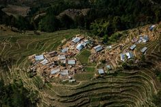 Earthquake-flattened homes are seen from an Indian military helicopter above a village in the Nuwakot district in Nepal. The helicopter was unable to find a stable or large enough area to land, so it hovered above the narrow hillside farmland, and army personnel threw food from the aircraft. May 1, 2015.