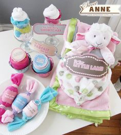 Baby Gift ideas + Free Printable. Rolled up onsesies and washcloths to make Parfaits, Cupcakes, and candies!