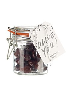 Mini jars filled with olives are an easy and tasty wedding favor