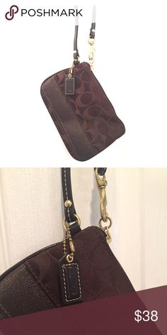Brown Coach Wristlet Adorable brown Coach Wristlet with gold metal hardware. Zipper works perfectly! Never used, in wonderful condition! Coach Bags Clutches & Wristlets