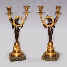 A fine Pair of early 19th Century Regency period bronze and ormolu 2-light Candelabra in the form of winged cherubs standing on spheres, holding double candle-arms with central flower garland raised on engine turned socle ending on green marble plinth. Circa: 1835 Ref: 5677