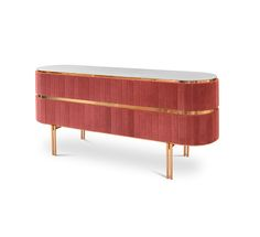 Edith is an exclusive and unique sideboard, upholstered with a smooth pink fabric. A grey textured marble top stands out for its high-end look, while pink and gold contrast with each other, flowing through the structure of the sideboard. Gold brass legs and details make up for a bohemian look on this desirable sideboard.