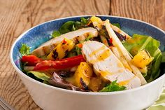 Pineapple slices and fresh lime juice add sweet and citrusy appeal to this weeknight-quick Grilled Chicken & Fruit Salad.