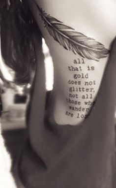 Classy  beautiful feather/ quote ribs tattoo