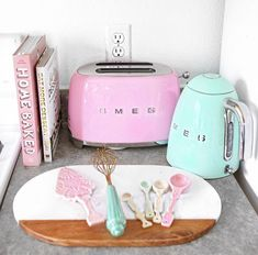 http://www.kitchensetupideas.com/category/Utensil-Organizer/ kitchen goals.. Smeg appliances comes in cute pastel colors.