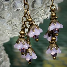 pink opalescent flower earrings by twentypoundtabby, via Flickr