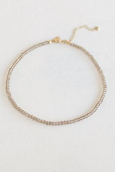 GNO...its a girls night! Make every night as good as a girls night with this taupe beaded choker! You can wear this baby alone because it is such a stand out piece! Gold, adjustable clasp link closure