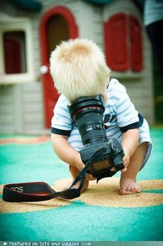 self portrait :) But really, this is a great idea. Give the kid a camera and then take photos of him taking photos.