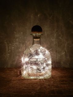 I have this patron silver bottle. This pic give me an idea what to do with the empty bottle. However this link is for an etsy listing to buy this.